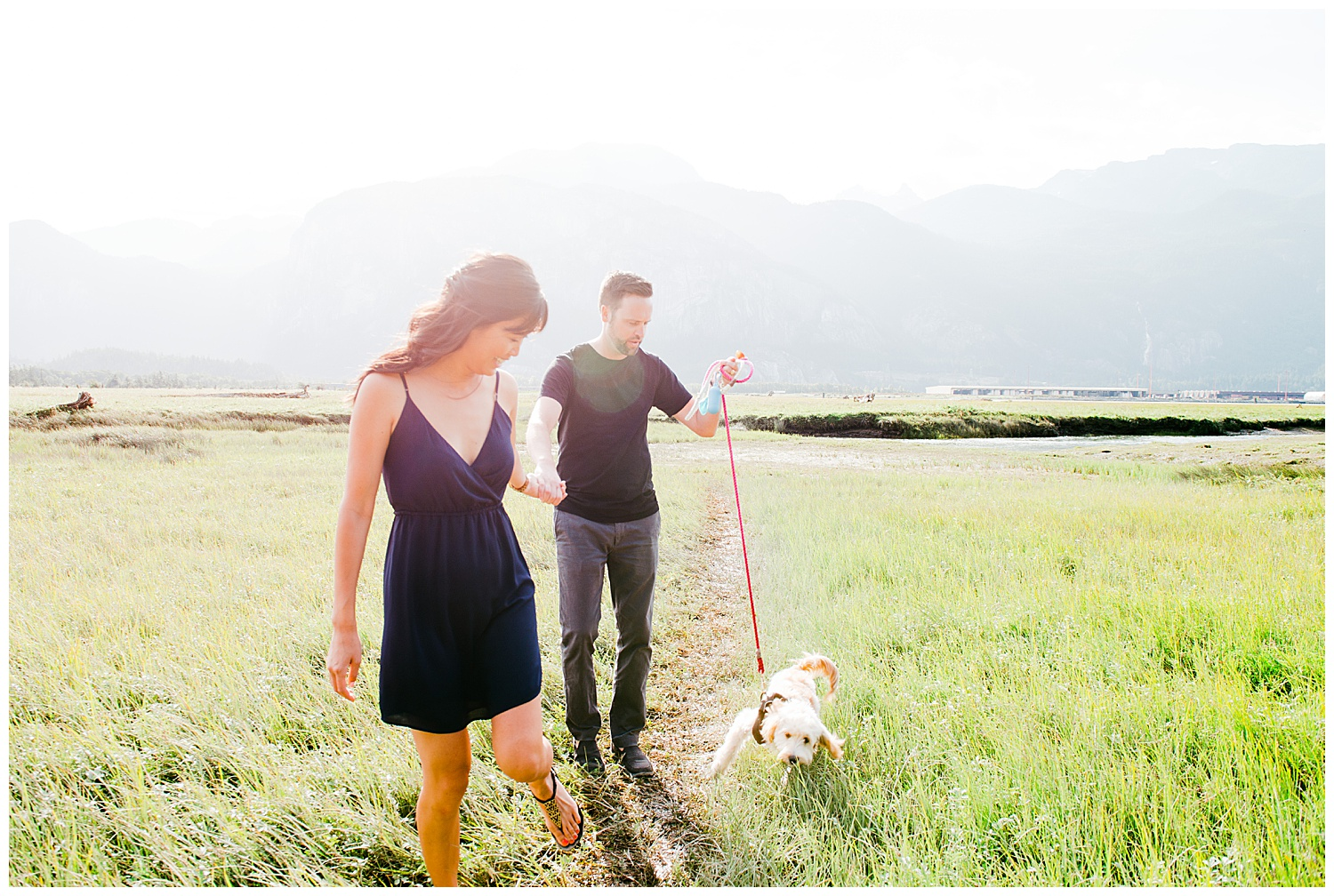 B.C.  Canada,British Columbia wedding photographer,Okanagan wedding photographer,Squamish B.C.,Squamish engagement,big open fields,chief stewamus,dog,garibaldi park,giggeling,grasslands,kelowna wedding photographer,laughing,light,maylies lang photography,mountain,puppy,summer,the pit squamish b.c.,vancouver enagement photographer,vancouver wedding photographer,vernon wedding photographer,wedding photographer,